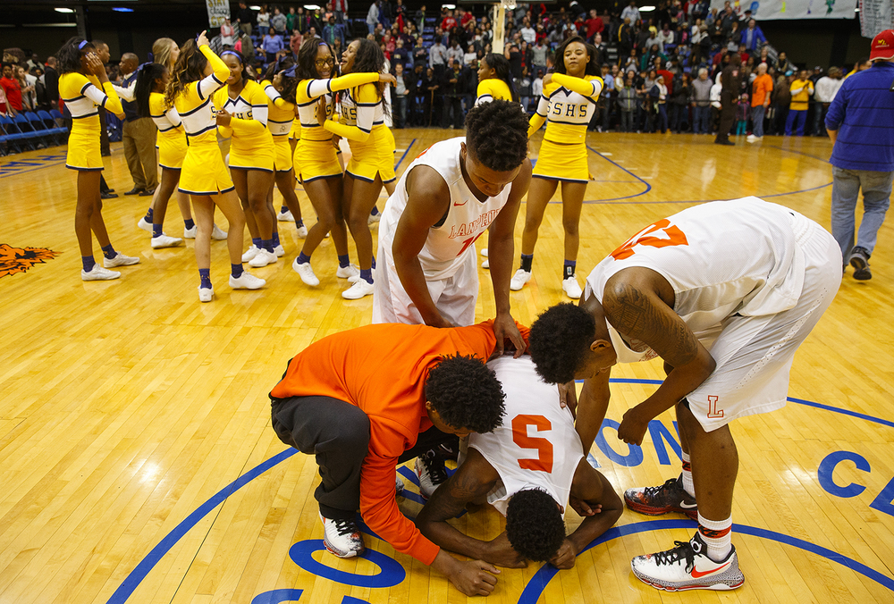 Lanphier's Xavier Bishop collapses on the court after the Lions lost to Southeast 79-74during the City Tournament championship game at the Prairie Capital Convention Center Saturday, Jan. 23, 2016. Ted Schurter/The State Journal-Register
