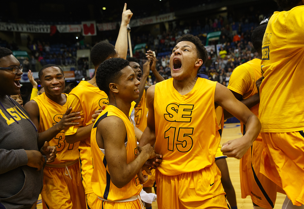 Southeast's Jordan Stapleton lets out a scream as the Spartans celebrate their win against Lanphier during the City Tournament championship game at the Prairie Capital Convention Center Saturday, Jan. 23, 2016. Ted Schurter/The State Journal-Register