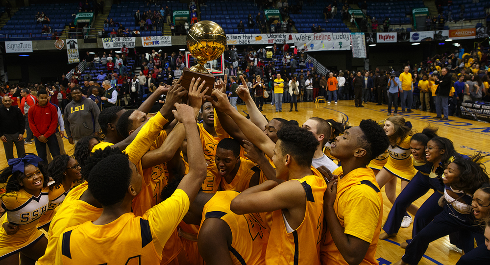 The Southeast Spartans celebrate their win against Lanphier during the City Tournament championship game at the Prairie Capital Convention Center Saturday, Jan. 23, 2016. Ted Schurter/The State Journal-Register