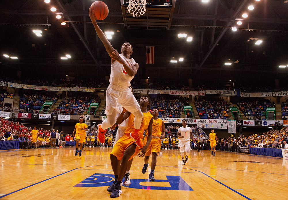 Lanphier Xavier Bishop beats Southeast's Anthony Fairlee to the hoop during the City Tournament championship game at the Prairie Capital Convention Center Saturday, Jan. 23, 2016. Ted Schurter/The State Journal-Register