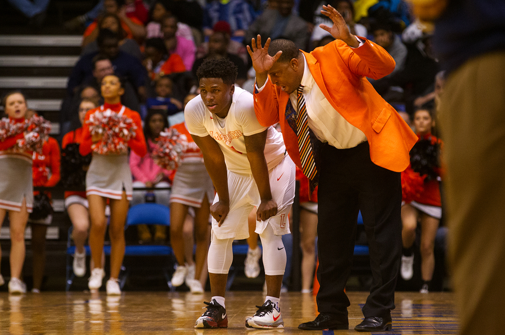 Lanphier's Blake Turner talks with Yaakema Rose on the sidelines after he picked up his fourth foul against Southeast during the City Tournament championship game at the Prairie Capital Convention Center Saturday, Jan. 23, 2016. Ted Schurter/The State Journal-Register