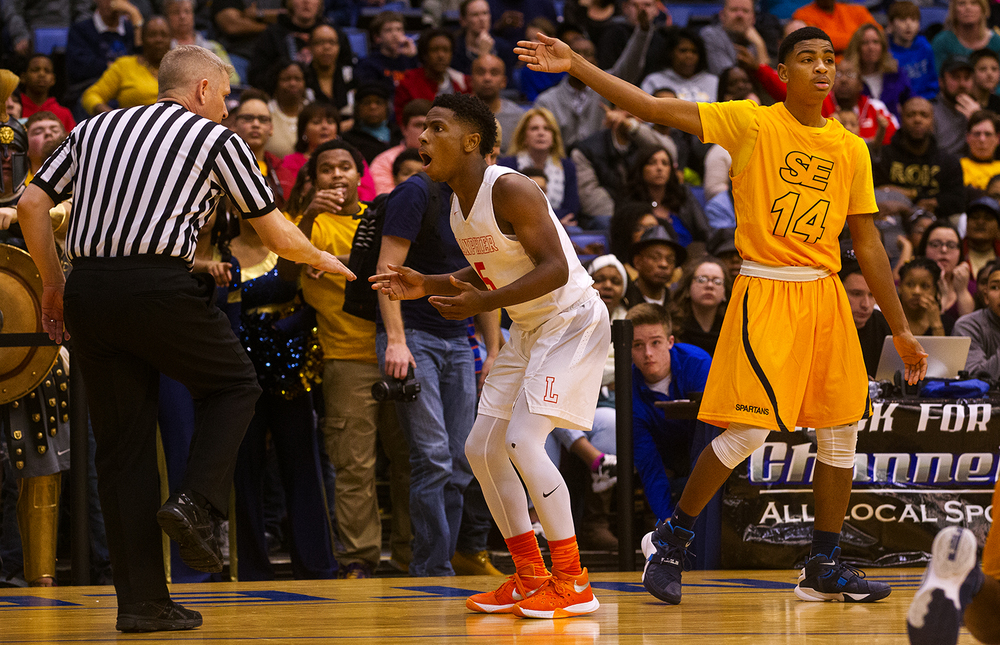 Lanphier's Xavier Bishop can't believe he just picked up his third foul against Southeast during the City Tournament championship game at the Prairie Capital Convention Center Saturday, Jan. 23, 2016. Ted Schurter/The State Journal-Register