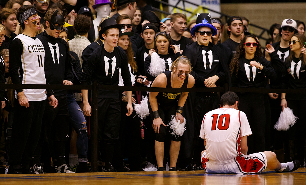 The Sacred Heart-Griffin student section has no sympathy for Springfield's Trevor Minder as he sits on the court during the City Tournament at the Prairie Capital Convention Center Saturday, Jan. 23, 2016. Ted Schurter/The State Journal-Register