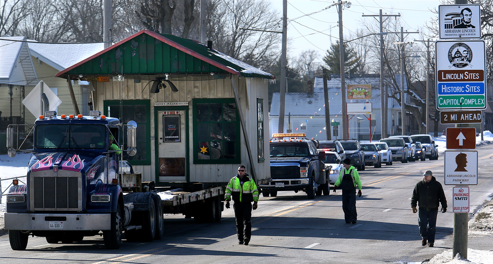 The Mahan's Filling Station building, carefully secured on the rear of a large flatbed trailer pulled by Shaner's Towing, makes its way slowly north on Peoria Road (Old Rt. 66) in route to its new home next to Fulgenzi's Pizza and Pasta. David Spencer/The State Journal-Register