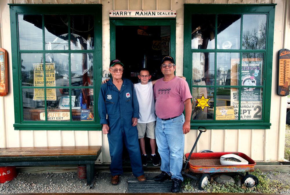 In this photograph taken on April 3, 2012, three generations of the Shea family stand for a portrait in front of Mahan's Filling Station next to Shea's Gas Station and Museum, a Springfield and Old Route 66 landmark which first opened in 1995 at 2075 Peoria Rd. From left to right: Bill Shea, then 90, Shea's great-grandson Jordan Shea, 10, and Bill Shea's son Bill Shea. Photo by David Spencer/The State Journal-Register