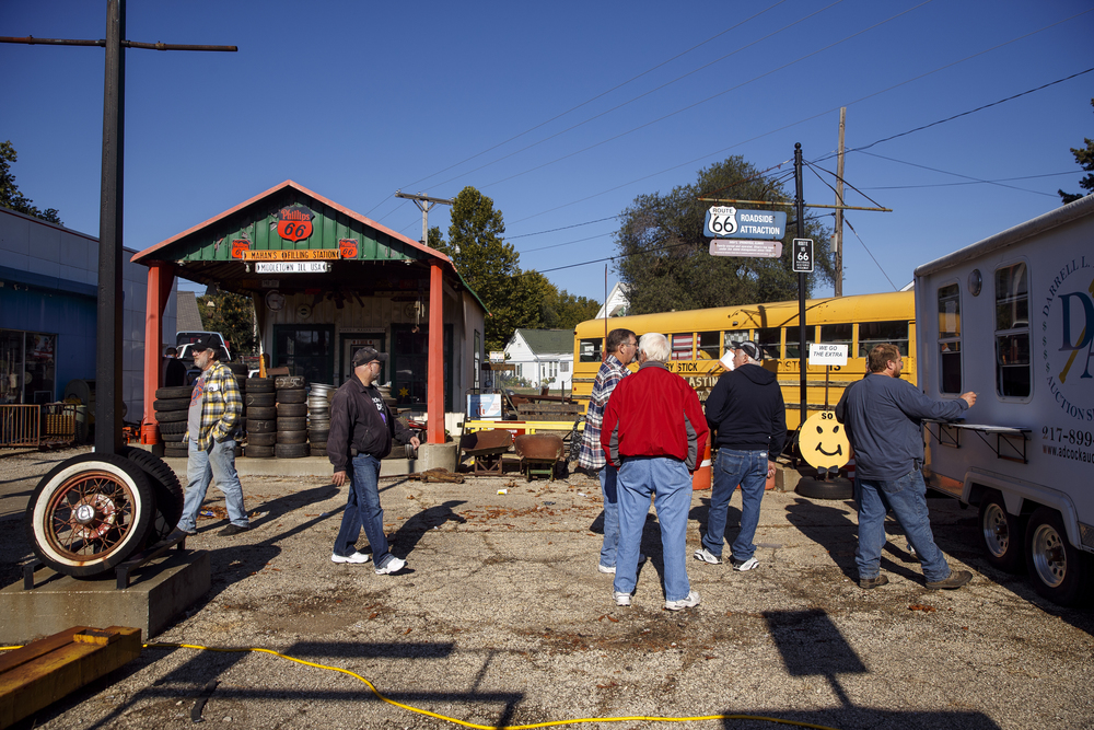 The former Mahan's Filling Station can be seen at left in background as customers line up to register for the auction at Shea's Gas Station and Museum in Springfield on Saturday, Oct. 10, 2015. Ted Schurter/The State Journal-Register