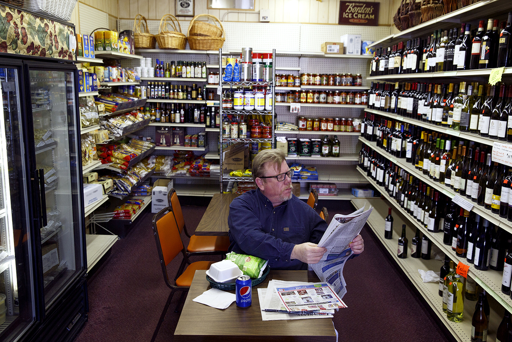 Josh Hedstrom catches up on the news while eating lunch at the Food Mart Dec. 18, 2015, something he said he did frequently. Rich Saal/The State Journal-Register