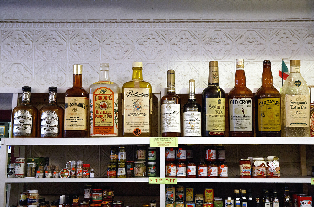 Display liquor bottles line a top shelf at the Food Mart Tuesday, Jan. 26, 2016. Rich Saal/The State Journal-Register