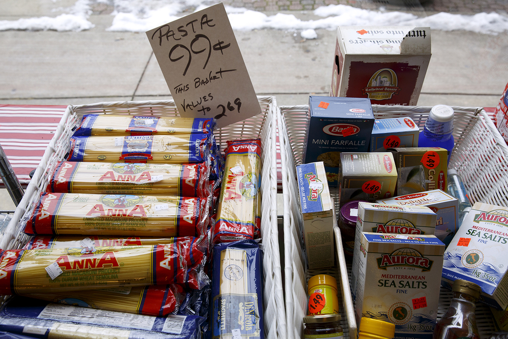 Sale items on display in the front window of the Food Mart Tuesday, Jan. 26, 2016.Rich Saal/The State Journal-Register