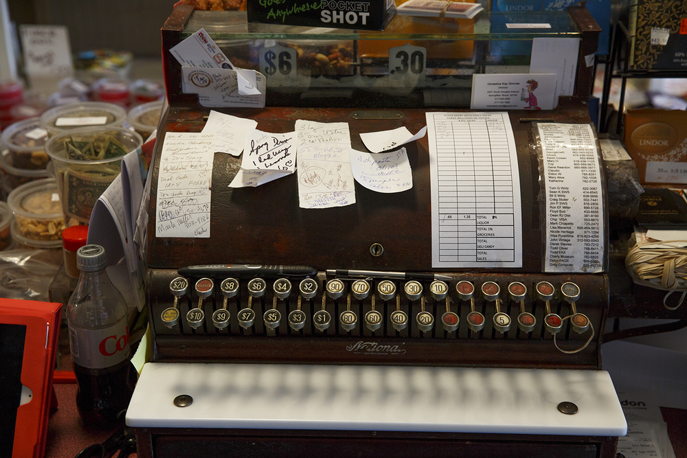 The Food Mart cash register goes back generations in the Pirrea family. Rich Saal/The State Journal-Register.
