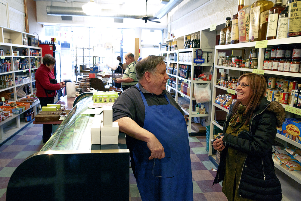 "Debi Vaninger visits with Tony Pirrera Tuesday, Jan. 26, 2016 at The Food Mart in downtown Springfield. Tony and his brother Pete, fifth-generation owners, are retiring.""We're going to miss our bright spot of the day,"" said Vaninger, who has visited the shop for years to shop and tease the brothers. The shop's final day open is Saturday. Rich Saal/The State Journal-Register"