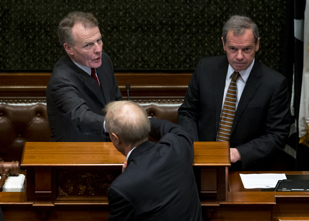 House Speaker Michael Madigan, left, and Senate President John Cullerton, shake hands with Illinois Gov. Bruce Rauner prior to his State of the State address to a joint session of the General Assembly in the House chambers at the Illinois State Capitol, Wednesday, Jan. 27, 2016, in Springfield, Ill. Justin L. Fowler/The State Journal-Register