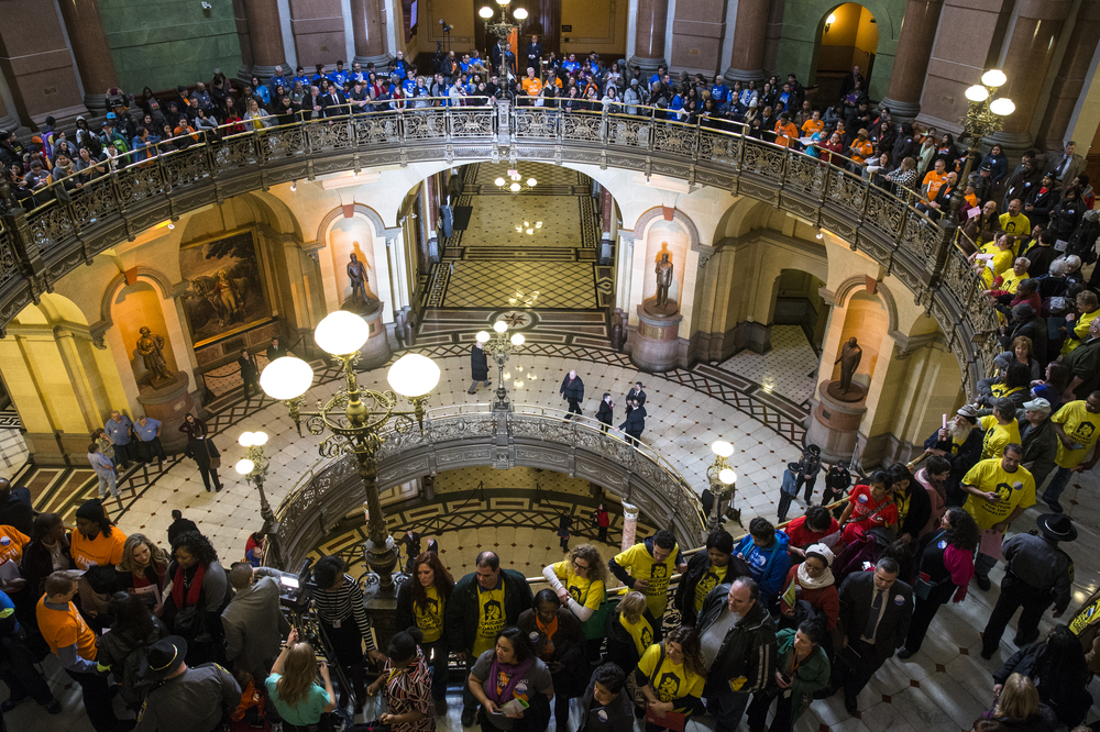 Protesters from different groups gather outside the Illinois House Chambers prior to Illinois Gov. Bruce Rauner's State of the State address at the Illinois State Capitol, Wednesday, Jan. 27, 2016, in Springfield, Ill. Justin L. Fowler/The State Journal-Register