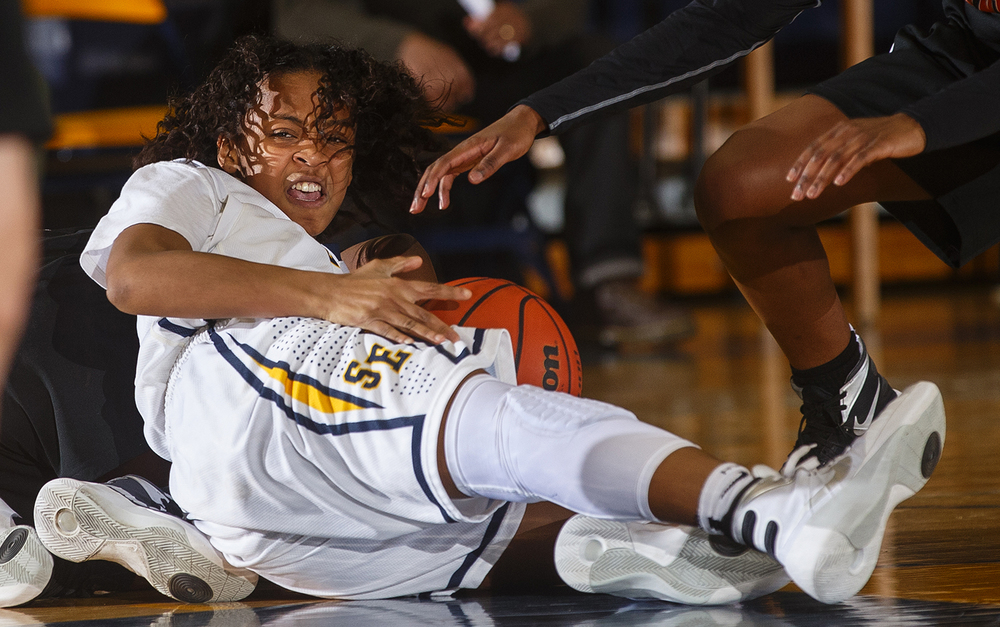 Southeast's Adrianna Brown comes up with a loose ball against Lanphier during the Girls City Tournament consolation game at Southeast High School Thursday, Jan. 27, 2016. Ted Schurter/The State Journal-Register
