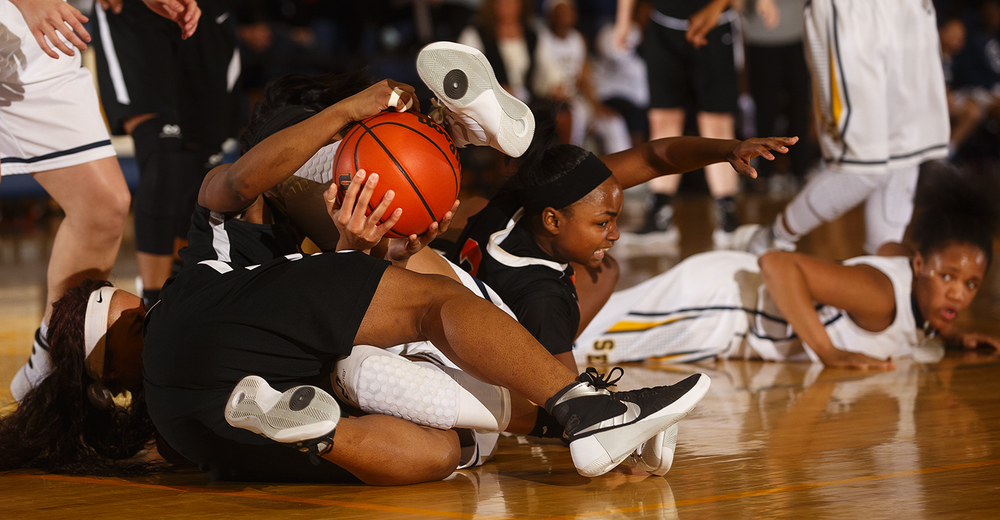 Spartans and Senators collide on the floor as they dive for a loose ball during the Girls City Tournament consolation game at Southeast High School Thursday, Jan. 27, 2016. Ted Schurter/The State Journal-Register