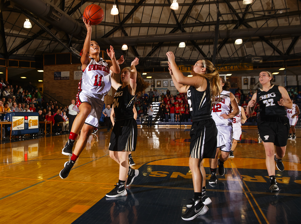Springfield's Kyra Webster drives the lane against Sacred Heart-Griffin during the Girls City Tournament title game at Southeast High School Thursday Jan. 28, 2016. Ted Schurter/The State Journal-Register