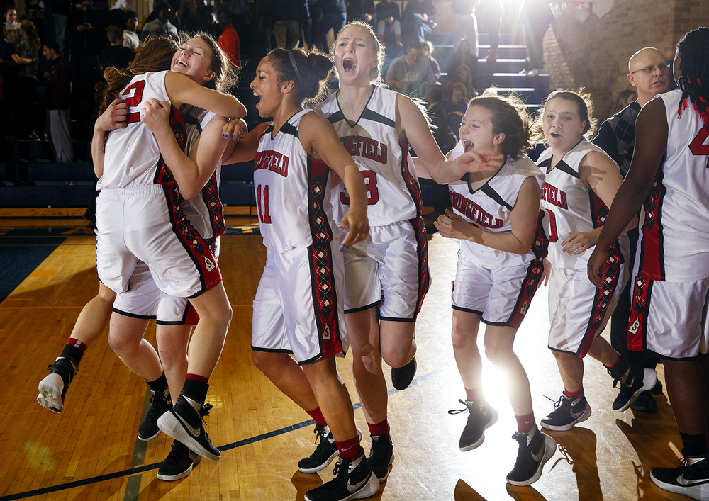 The Springfield Senators celebrate their come-from-behind victory against Sacred Heart-Griffin during the Girls City Tournament title game at Southeast High School Thursday Jan. 28, 2016. Ted Schurter/The State Journal-Register