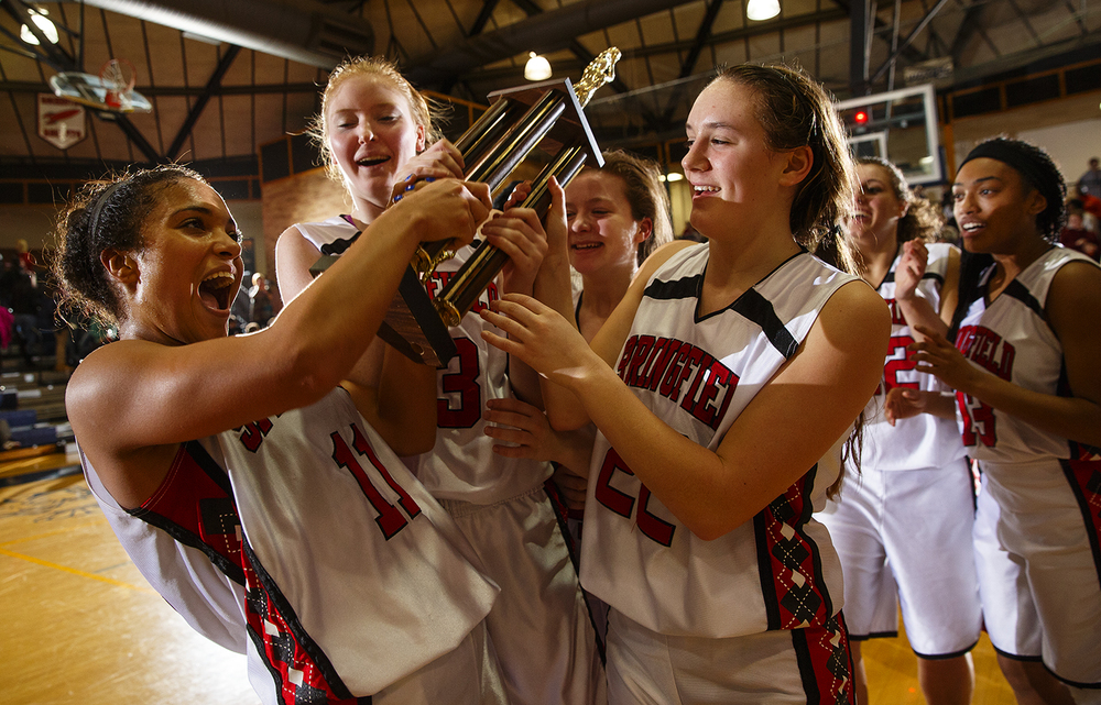 Springfield's Kyra Webster and Ellie Brandt and Sarah Cross celebrate with the trophy after defeating Sacred Heart-Griffin during the Girls City Tournament title game at Southeast High School Thursday Jan. 28, 2016. Ted Schurter/The State Journal-Register