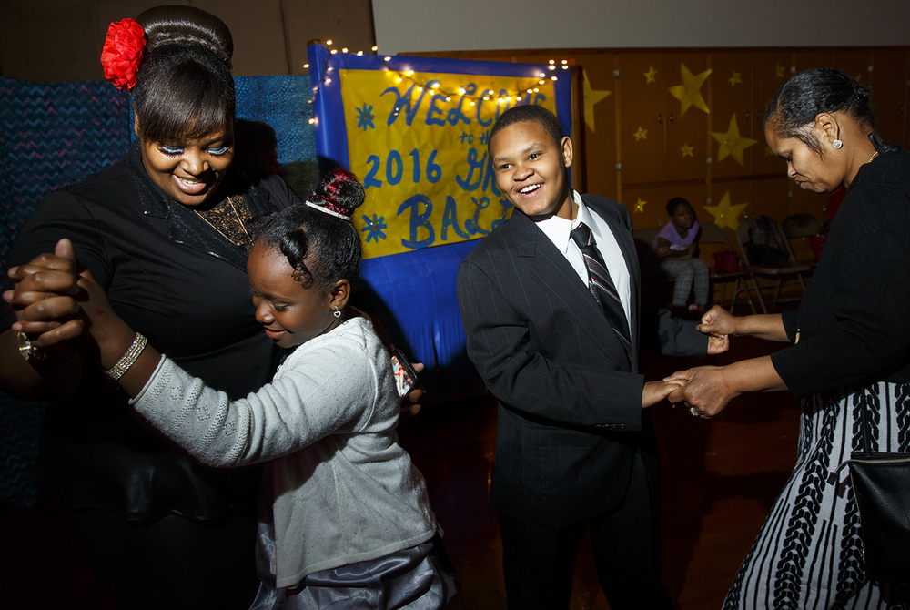 "Kyan Willis dances with his grandmother Florence Miller as his mom Chaneice Miller dances with his sister Aaleyah Morgan during the Dubois Elementary School second annual ""Grand Ball"" Friday, Jan. 29, 2016. Students and their guests dressed up in formal attire could entertain themselves on the dance floor, at the photo booth or enjoy ""fancy"" refreshments.  Ted Schurter/The State Journal-Register"