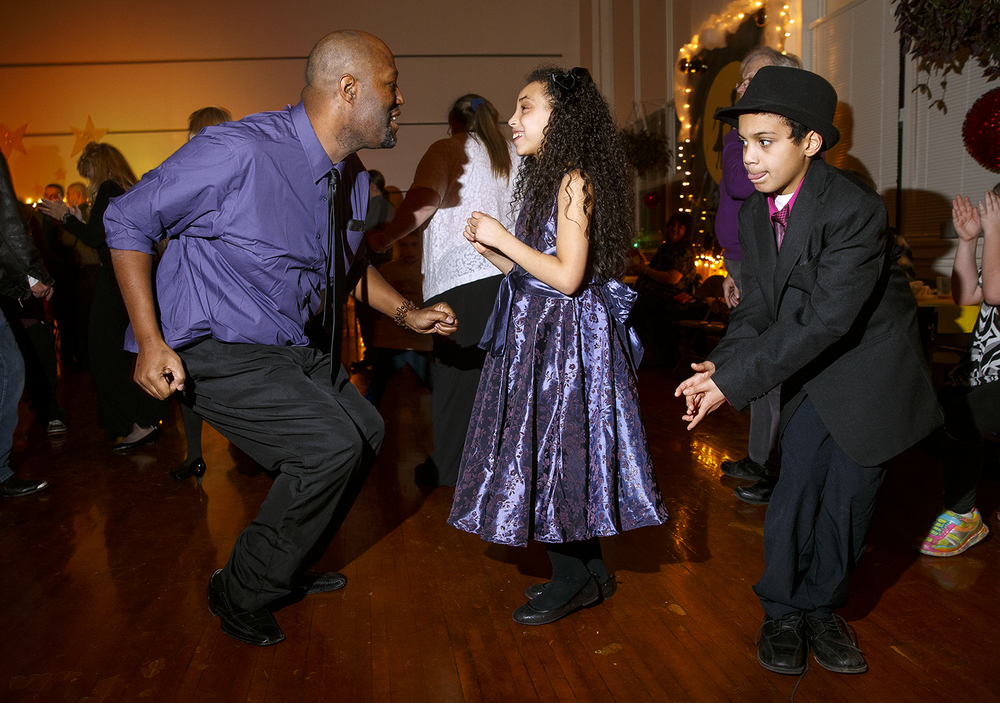 "Rasheed Riley gets down low as  he dances with his daughter Kayla Hermann and son Shaunessy during the Dubois Elementary School second annual ""Grand Ball"" Friday, Jan. 29, 2016. Students and their guests dressed up in formal attire could entertain themselves on the dance floor, at the photo booth or enjoy ""fancy"" refreshments. Ted Schurter/The State Journal-Register"
