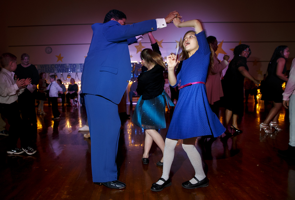 "Jim Deal spins his granddaughter Kaleya Deal during the Dubois Elementary School second annual ""Grand Ball"" Friday, Jan. 29, 2016. Students and their guests dressed up in formal attire could entertain themselves on the dance floor, at the photo booth or enjoy ""fancy"" refreshments.  Ted Schurter/The State Journal-Register"