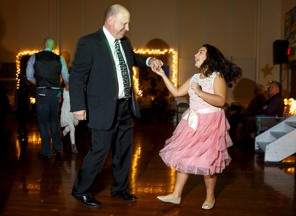 "Mike Garcia dances with his granddaughter Bella Eguez during the Dubois Elementary School second annual ""Grand Ball"" Friday, Jan. 29, 2016. Students and their guests dressed up in formal attire could entertain themselves on the dance floor, at the photo booth or enjoy ""fancy"" refreshments. Ted Schurter/The State Journal-Register"