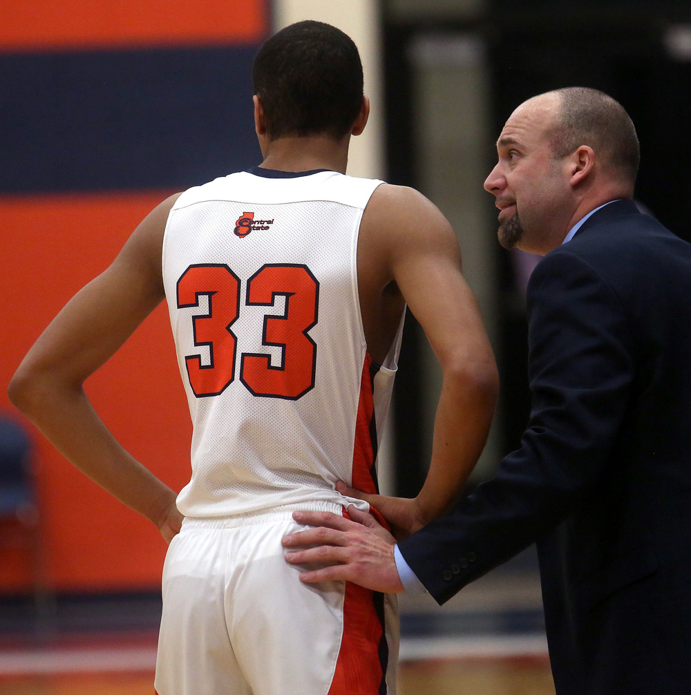 Rochester head coach Mike Steers has a few words with starter Collin Stallworth near the half as the Rockets were down nearly 15 points. David Spencer/The State Journal Register