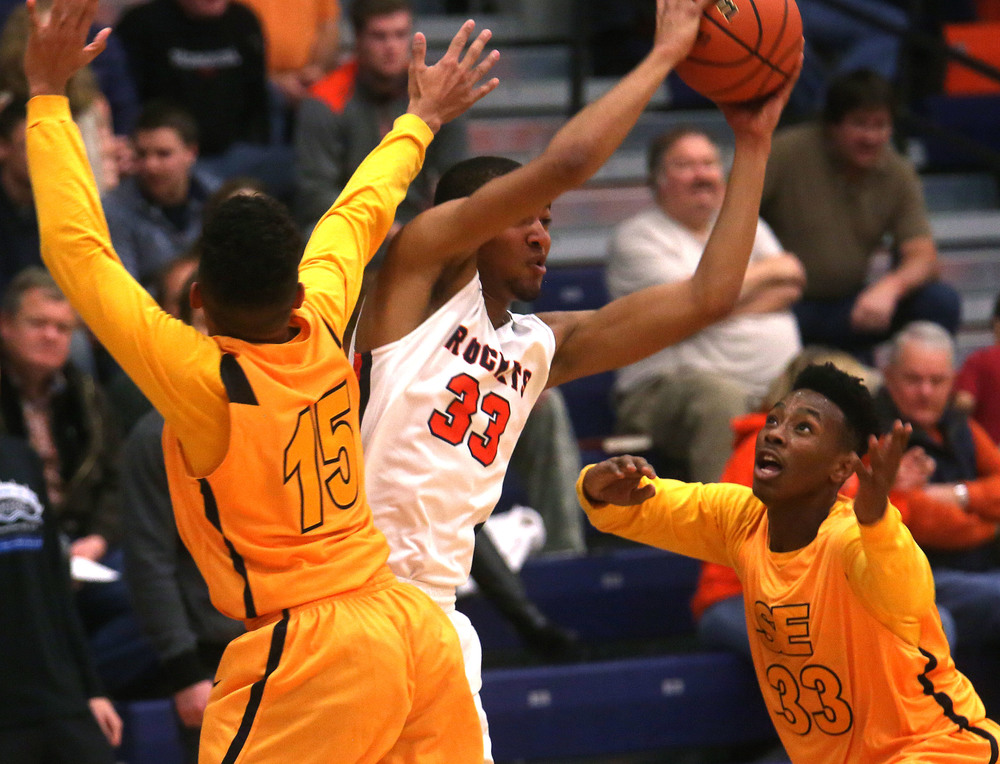 Southeast player Mark Johnson at right defends against Rochester player Collin Stallworth from making a pass. David Spencer/The State Journal Register