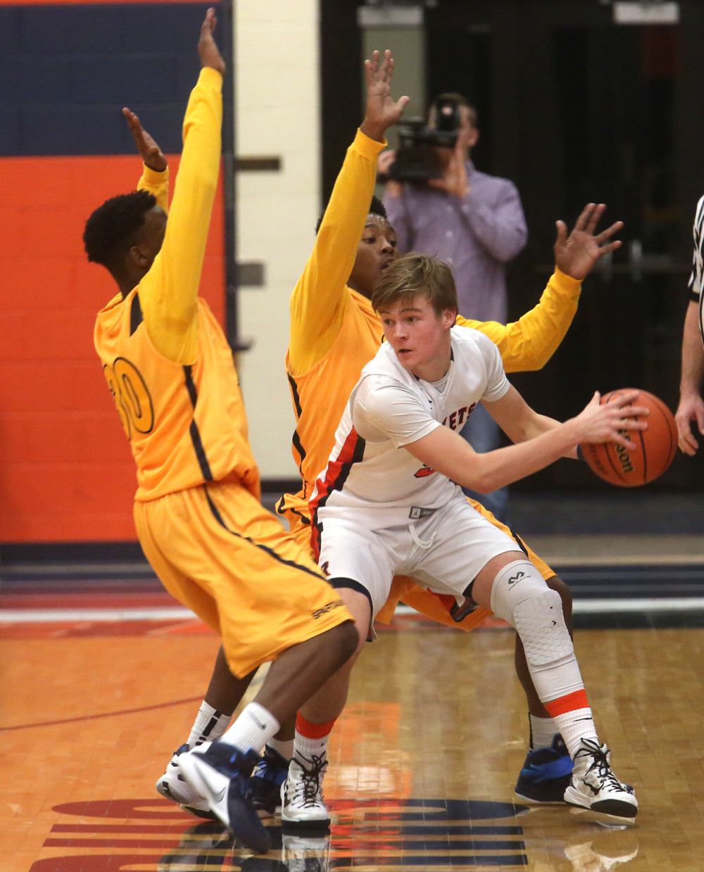 Rochester player Dalton Handlin tries to get the ball around Southeast players including D'Angelo Hughes at left.David Spencer/The State Journal Register