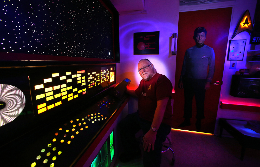 A cutout of show character Dr. Leonard McCoy at right takes up permanent residence inside the mancave, with Les Blain seated in front of Spock's science station on Friday, Jan. 29, 2016. David Spencer/The State Journal Register