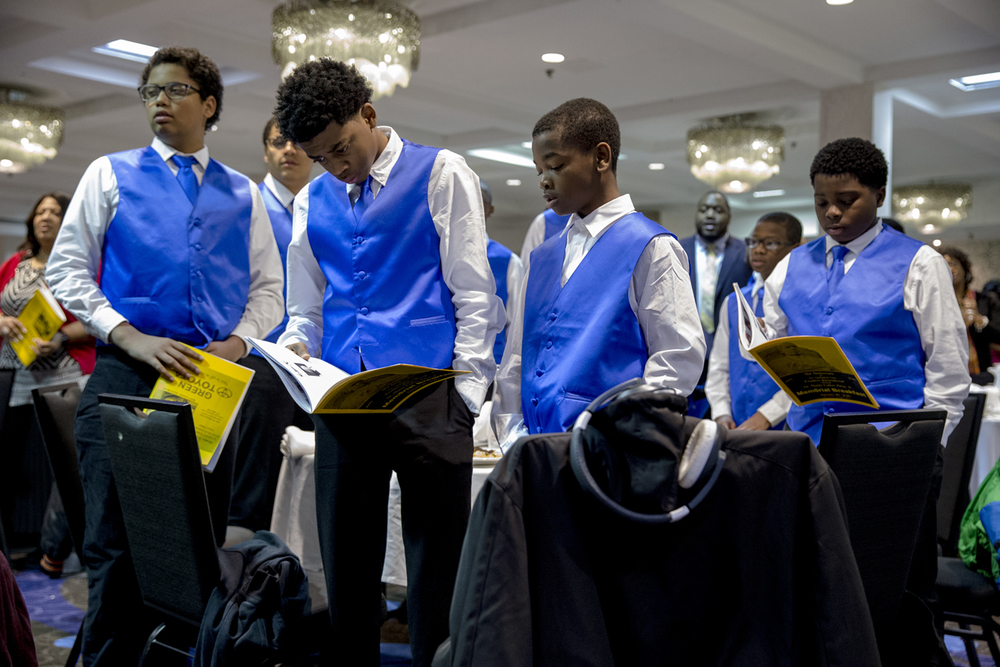 """Members of the Sigma Beta Club, a youth auxiliary group through the Phi Beta Sigma Fraternity, stand as they get ready to sing along to """"We Shall Overcome"""" during the 41st Springfield Club Frontiers International Dr. Martin Luther King Jr. Memorial Breakfast at the Wyndham City Centre, Monday, Jan. 18, 2016, in Springfield, Ill. Justin L. Fowler/The State Journal-Register"""