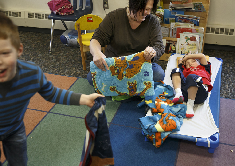Amanda Ross wakes Garrett Adams from his afternoon nap at Beginning Steps Child Development Center Tuesday, Jan. 19, 2016. A change in eligibility restrictions for the state's subsidized child-care assistance program has decreased the number of children the business serves. Ted Schurter/The State Journal-Register