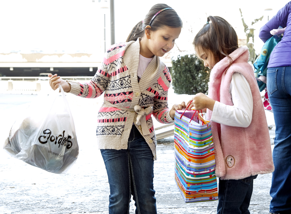 Madeleine Pauly checks her sister Leah's gift bag as she prepares to donate her birthday presents to St. John's Children's Hospital Wednesday, Jan. 20, 2016. Madeleine was inspired to donate gifts after being given a teddy bear to hold during an MRI procedure there and asked guests at her recent birthday party to bring an item from the pediatric wish list at St. John's Children's Hospital.  Ted Schurter/The State Journal-Register
