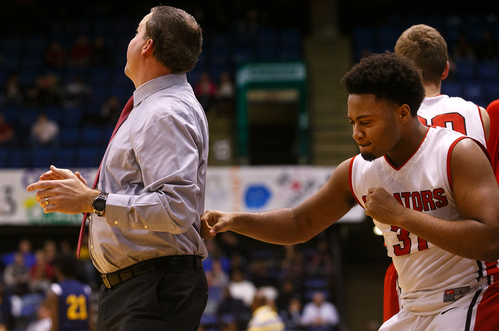 Springfield's Rahkeem Hawkins fake punches coach Preston Snarr as he celebrates a Springfield rally against Southeast during the City Tournament at the Prairie Capital Convention Center Friday, Jan. 22, 2016. Ted Schurter/The State Journal-Register
