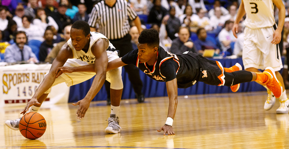 Sacred Heart-Griffin's Avery Andrews gets to a loose ball as Lanphier's Aundrae Williams dives for it during the City Tournament at the Prairie Capital Convention Center Friday, Jan. 22, 2016. Ted Schurter/The State Journal-Register