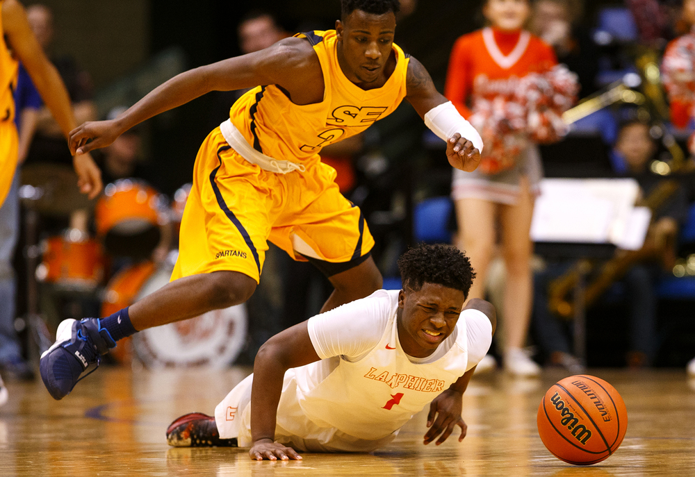 Lanphier's Yaakema Rose dives for the ball as Southeast's D'Angelo Hughes leaps over him during the City Tournament championship game at the Prairie Capital Convention Center Saturday, Jan. 23, 2016. Ted Schurter/The State Journal-Register