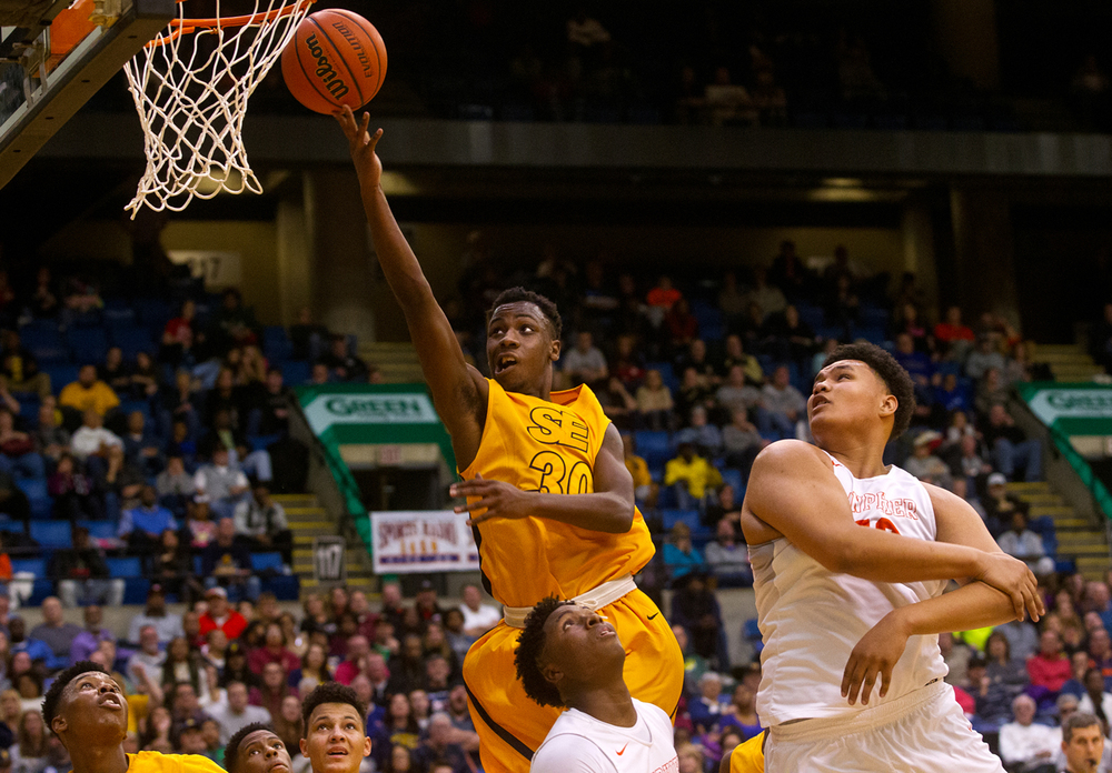 Southeast's D'Angelo Hughes scores two against Lanphier during the City Tournament championship game at the Prairie Capital Convention Center Saturday, Jan. 23, 2016. Ted Schurter/The State Journal-Register