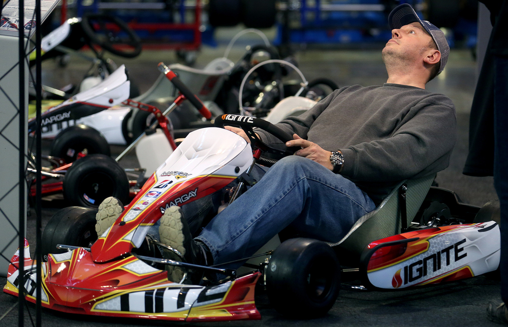 Chatham resident Steve Everitt leans back in an extra large seat that was a feature of an Ignite model racing kart made by Margay for sale at the show on Friday. The Winter Kart Show, featuring new 2016 racing go-kart chassis brands, sprint and dirt karts, quarter midgets and new and used karts as wellas parts for sale opened for a two-day run at the Orr Building at the Illinois State Fairgrounds on Friday, Jan. 22, 2016.  Benefitting the Mid-State Kart Club, the show, which also features a swap meet, continues on Saturday Jan. 23 from 9 am to 3 pm.  David Spencer/The State Journal-Register