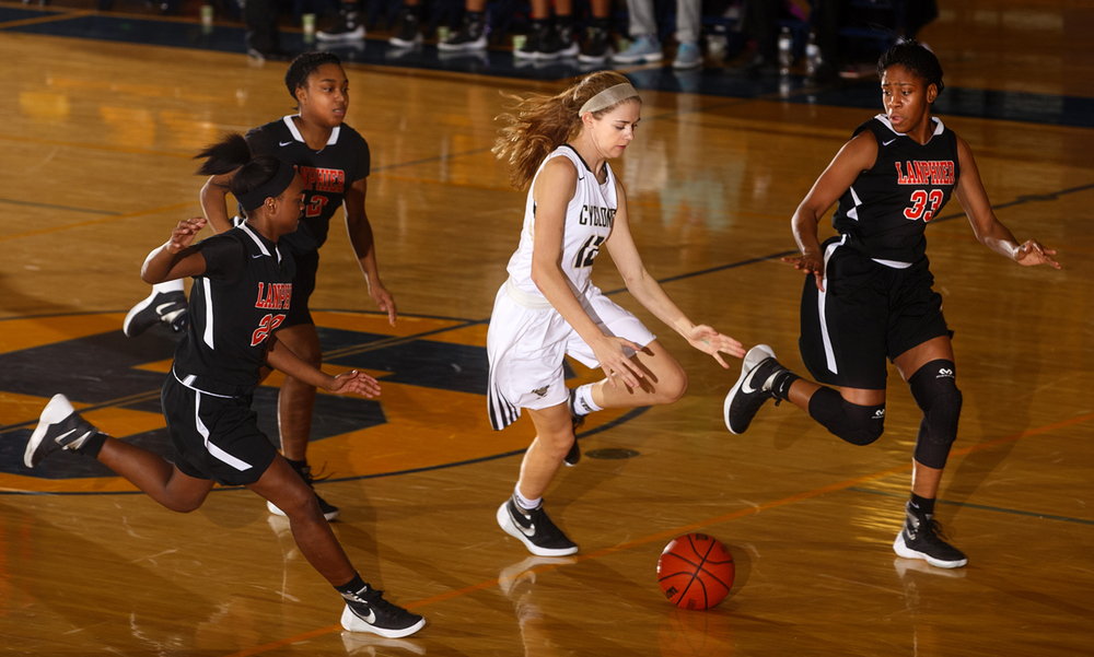 Sacred Heart-Griffin's Catie Eck brings the ball up among a trio of Lanphier defenders during the Girls City Tournament at Southeast High School Wednesday, Jan. 27, 2016.