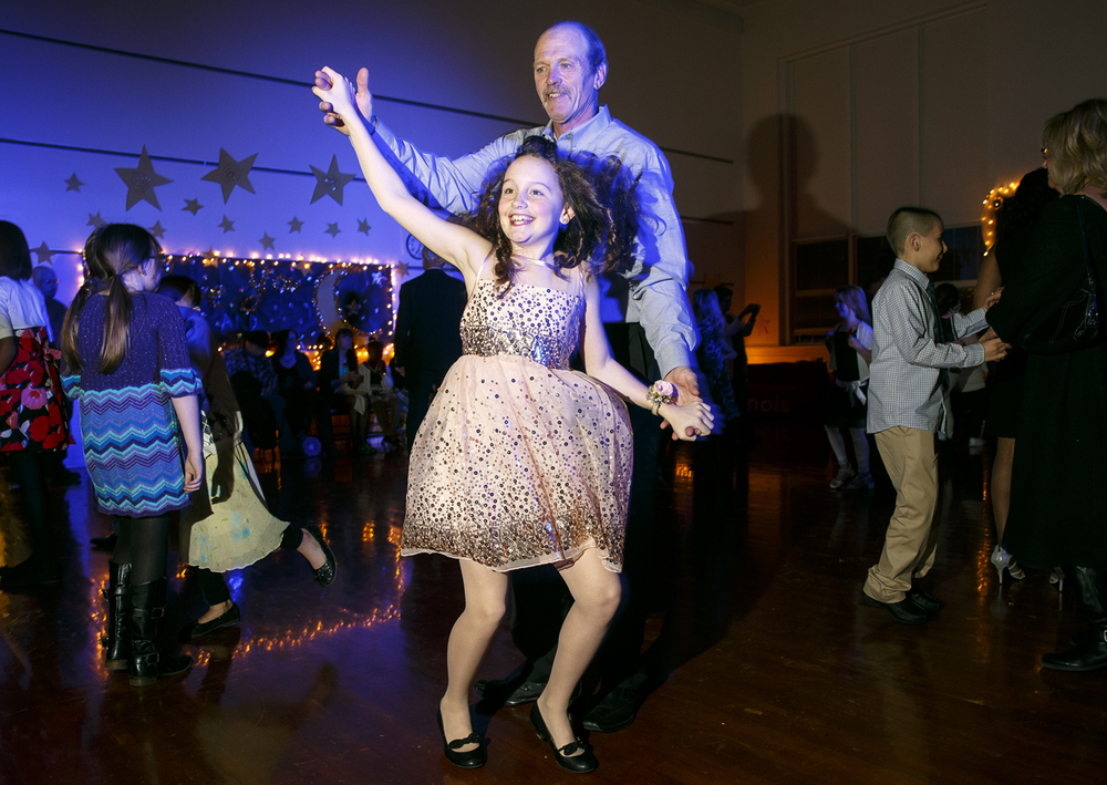 "Isabella Sexton dances with her grandfather Wayne Sexton during the Dubois Elementary School second annual ""Grand Ball"" Friday, Jan. 29, 2016. Students and their guests dressed up in formal attire could entertain themselves on the dance floor, at the photo booth or enjoy ""fancy"" refreshments. Ted Schurter/The State Journal-Register"