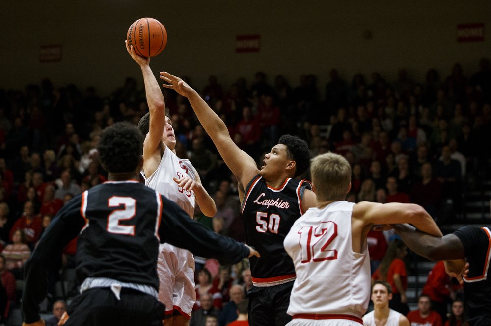 Glenwood's Joel Alexander (15) puts up a shot against Lanphier's William Boles (50) in the first quarter at Glenwood High School, Friday, Feb. 5, 2016, in Chatham, Ill. Justin L. Fowler/The State Journal-Register