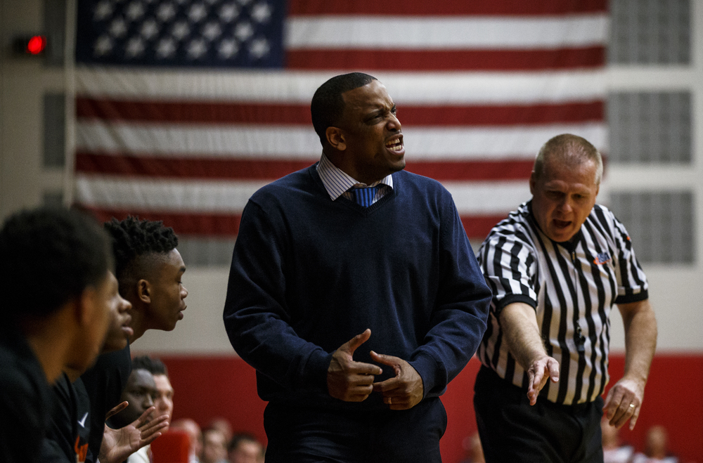 Lanphier head basketball coach Blake Turner reacts after one of his players is called for a foul as the Lions take on Glenwood in the first quarter at Glenwood High School, Friday, Feb. 5, 2016, in Chatham, Ill. Justin L. Fowler/The State Journal-Register