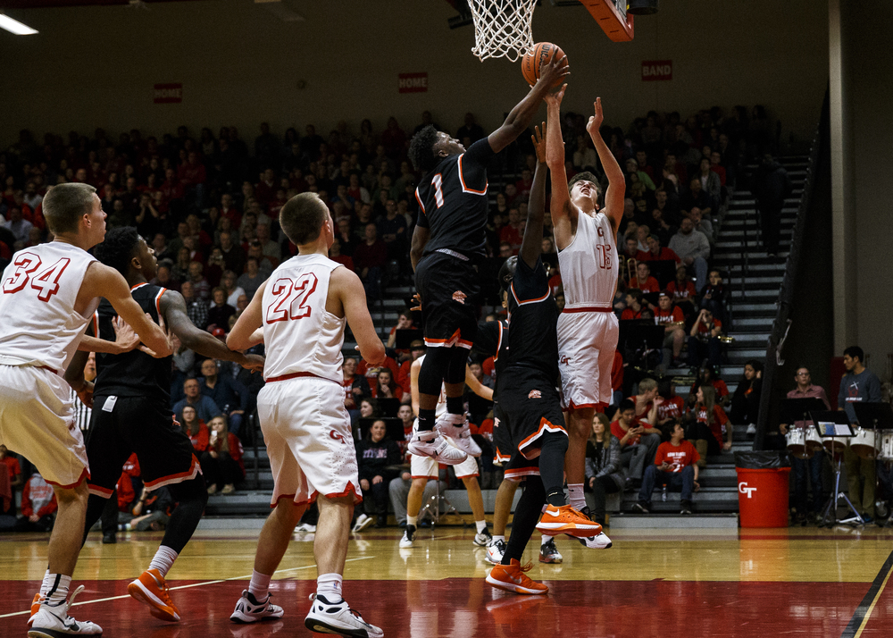 Lanphier's Yaakema Rose (1) blocks a shot form Glenwood's Joel Alexander (15) under the basket in the second quarter at Glenwood High School, Friday, Feb. 5, 2016, in Chatham, Ill. Justin L. Fowler/The State Journal-Register