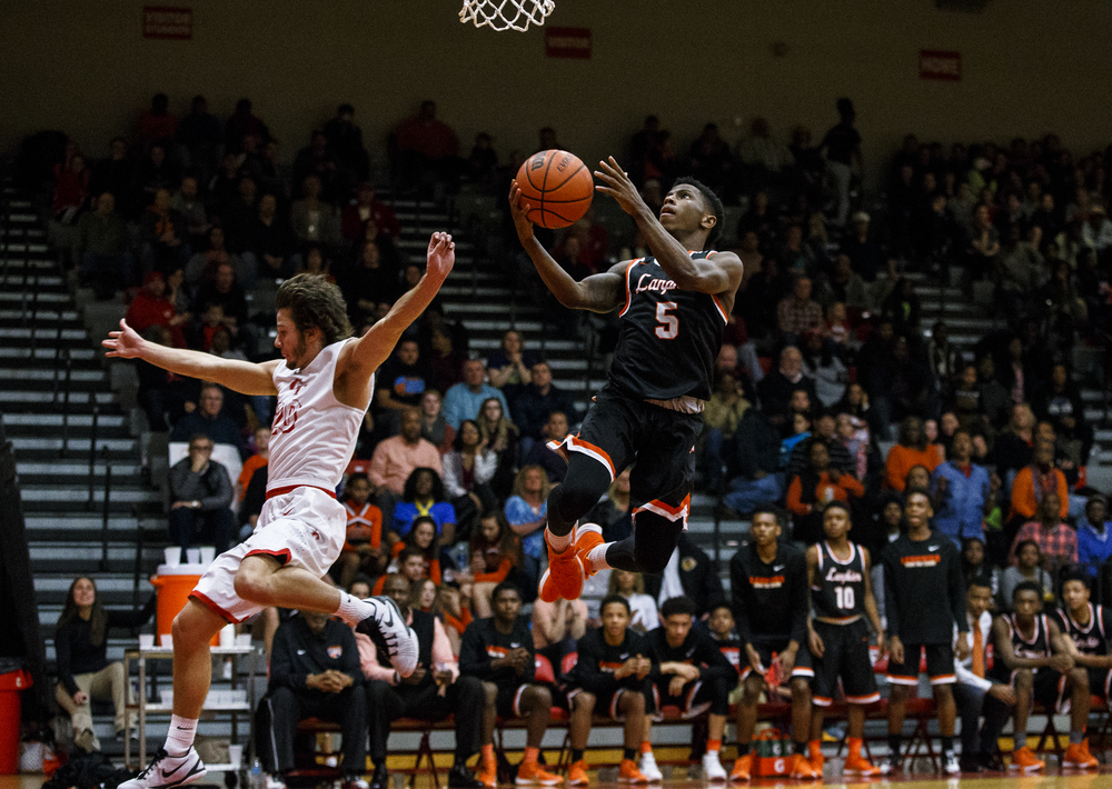 Lanphier's Xavier Bishop (5) goes in for a basket on a fast break against Glenwood's Ethan Hunt (20) in the third quarter at Glenwood High School, Friday, Feb. 5, 2016, in Chatham, Ill. Justin L. Fowler/The State Journal-Register