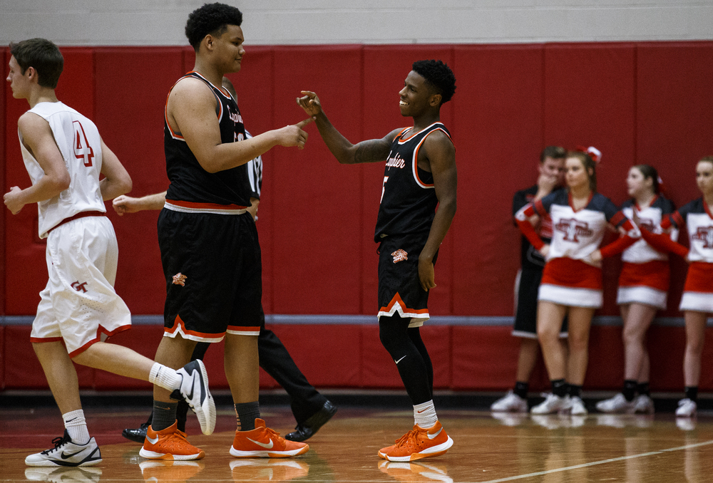 Lanphier's Xavier Bishop (5) celebrates with William Boles (50) after scoring a basket on a fast break against Glenwood in the third quarter at Glenwood High School, Friday, Feb. 5, 2016, in Chatham, Ill. Justin L. Fowler/The State Journal-Register
