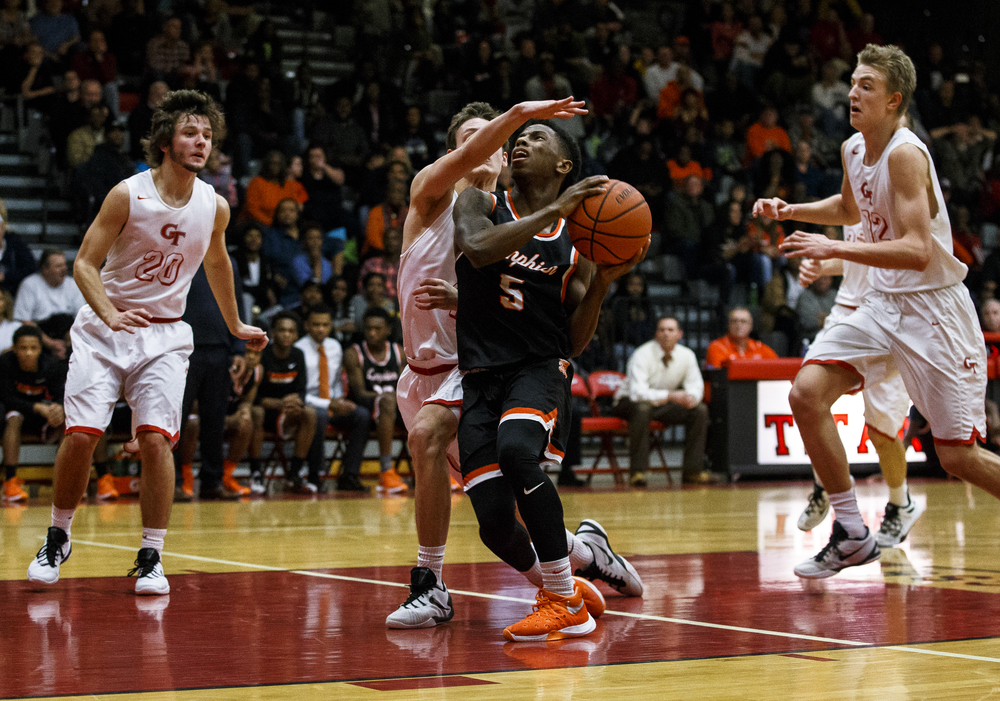 Lanphier's Xavier Bishop (5) draws the foul from Glenwood's Matt Bahlmann (4) as he drives to the basket in the third quarter at Glenwood High School, Friday, Feb. 5, 2016, in Chatham, Ill. Justin L. Fowler/The State Journal-Register