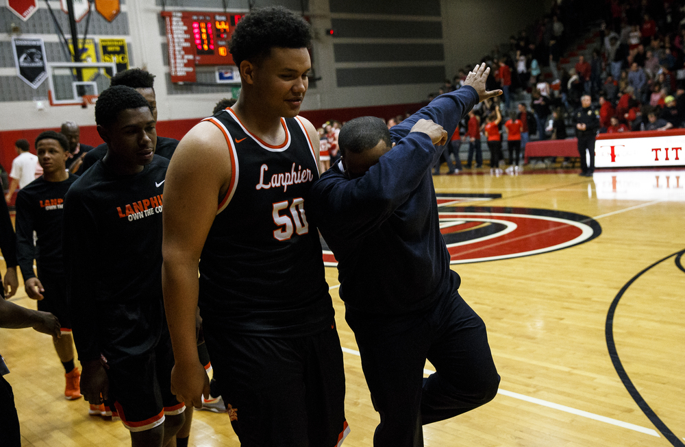 Lanphier head basketball coach Blake Turner celebrates as he walks off the court after the Lions defeated Glenwood 53-44 at Glenwood High School, Friday, Feb. 5, 2016, in Chatham, Ill. Justin L. Fowler/The State Journal-Register