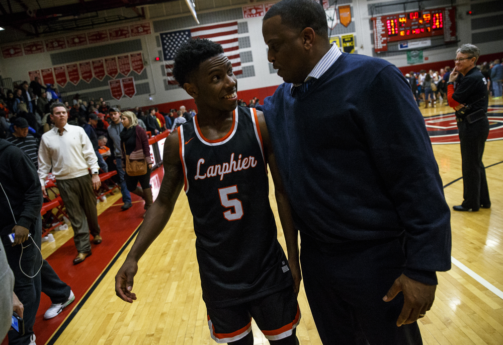 Lanphier's Xavier Bishop (5) and Lanphier head basketball coach Blake Turner celebrate after the Lions defeated Glenwood 53-44 at Glenwood High School, Friday, Feb. 5, 2016, in Chatham, Ill. Justin L. Fowler/The State Journal-Register