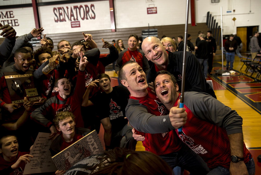 The Springfield wrestling coaches gather for a selfie with the team after the Senators won the team tittle in the IHSA Class 2A Springfield Regional at Willard Duey Gymnasium, Saturday, Feb. 6, 2016, in Springfield, Ill. Justin L. Fowler/The State Journal-Register