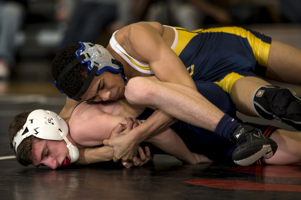 Southeast's James Melvin, right, wraps up Rochester's Mason Ross as he works him on the mat in the 106-pound championship match during the IHSA Class 2A Springfield Regional at Willard Duey Gymnasium, Saturday, Feb. 6, 2016, in Springfield, Ill. Justin L. Fowler/The State Journal-Register